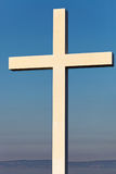 Cross as a symbol of Christianity with clear blue sky on background Stock Photos