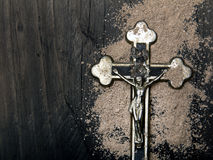 Cross and ash - symbols of Ash Wednesday Stock Photography