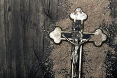 Cross and ash - symbols of Ash Wednesday. Stock Photo