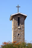 Cross Atop Roof of Bell Tower on Catholic Church Stock Photos