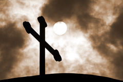 The cross on the background of the cloudy sky Royalty Free Stock Images