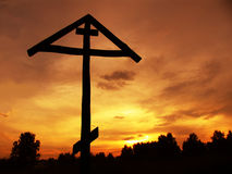 Cross on a background of the red sky Royalty Free Stock Photo