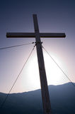 Cross In Backlight. A cross in backlight against the sky blue Stock Images