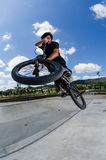 Cross bar. BMX rider jumps while doing cross bar trick Stock Photography