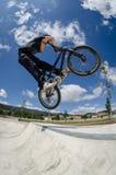 Cross bar. BMX rider jumps while doing cross bar trick Royalty Free Stock Image