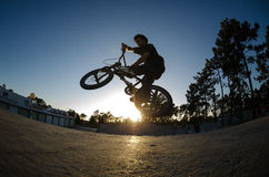 Cross bar. BMX rider jumps while doing cross bar trick Royalty Free Stock Images