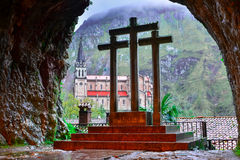 Cross and Basilica de Covadonga, from inside the holy cave Stock Photos