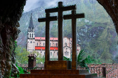 Cross and Basilica de Covadonga, from inside the holy cave II Royalty Free Stock Image