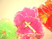 Cross with beads. Cross with beads in a colorful flower background stock photography