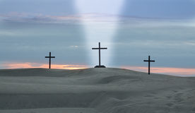 Cross Beam Of Light. Three crosses on a desert sand dune with a beam if  white light coming down form Heaven Royalty Free Stock Image