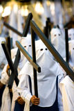 Cross Bearers in Semana Santa Procession. Marchers carry crosses through the streets of Spain in Holy Week parade royalty free stock photos