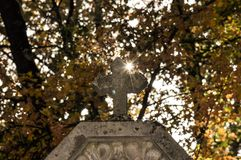 Cross with beam of light. Cross with beautiful autumn background royalty free stock photography