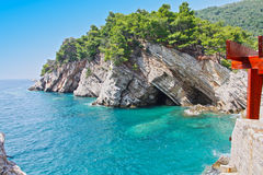 Cross bed rising from the sea. Petrovac, Montenegro Royalty Free Stock Photos