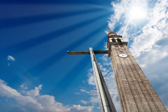Cross and Belfry on Blue Sky Royalty Free Stock Image