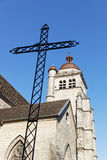 Cross an bell tower in Poligny Royalty Free Stock Photos