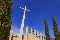 Cross and bells in the Sanctuary of Saint Pio from Pietrelcina, Apulia, Italy. Royalty Free Stock Image