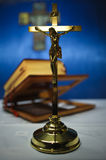Cross and bible. Golden rood and bible in the background Royalty Free Stock Images