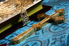 Cross and Bible. Orthodox cross and the Bible. Shallow depth of field. Focus on the the central part of the cross Stock Image