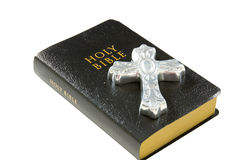 Cross and Bible. Silver cross lying on top of a black leather bible Royalty Free Stock Photo