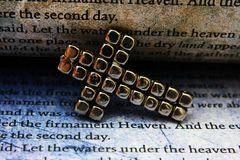 Cross and bible Stock Images