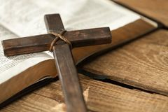 Cross on bible. Cross religious bible wooden hymn study Royalty Free Stock Image