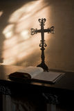 Cross and Bible inside a Church Royalty Free Stock Photo