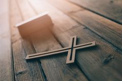 Cross and bible on old wooden background. Royalty Free Stock Photos