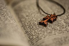 Cross and bible .   bible with rosary . Cross and bible. Close up of priest reading the holy bible with rosary Stock Image