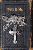 Cross on a bible Royalty Free Stock Photos