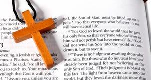 Cross on Bible verse John 3:16. Wooden cross next to the Bible verse of John chaper three verse sixteen Royalty Free Stock Photos