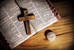 Cross on bible Stock Photos