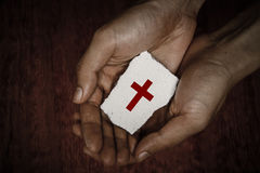 Cross Block In Hands Stock Photography