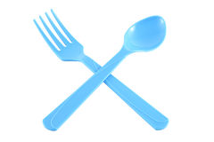 Cross blue plastic spoon and fork Stock Images