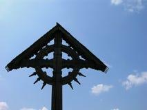 Cross On A Blue Sky. Black Cross Made From Abanos On A Blue Sky Stock Photography