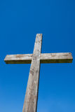 Cross with Blue Sky. A photo of a wooden cross taken looking up at a blue sky background Stock Photography