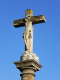 Cross in blue sky. An ancient catholic cross in blue sky stock image