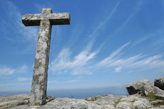 Cross in a blue sky stock images