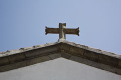 Cross in a blue sky background Stock Photo