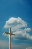 Cross and blue sky with clouds. Cross against blue sky with clouds Royalty Free Stock Photography