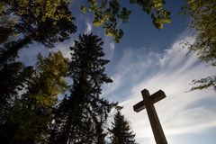 Cross in blue sky Stock Images