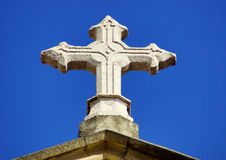 Cross and blue sky. Simple composition with stone cross, blue sky and sunlight Royalty Free Stock Photos