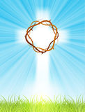 Cross on blue sky, with sun rays and green lawn Royalty Free Stock Photos