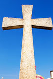Cross and blue sky. Vertical photo in color of a Christian cross in tomb and a blue sky royalty free stock photos