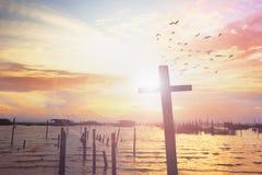 Cross on blurry sunset background stock image