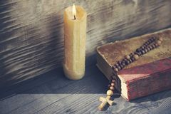 Cross, book and candle. On wooden background Stock Photos