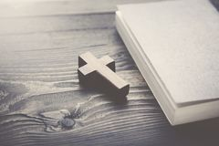 Cross and book. On a wooden table Royalty Free Stock Photography
