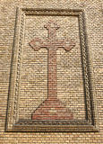 Cross on a brick wall Stock Photography