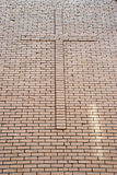 Cross on brick wall Stock Photos