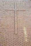 Cross on brick wall. Big cross on brick wall Stock Photos