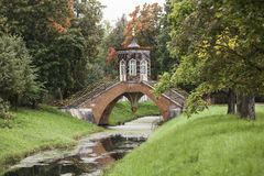 Cross the bridge. Alexander Park. Tsarskoye Selo. Russia. Cross the bridge spanned the Cross channel. Construction completed in 1779. The bridge stands on four Royalty Free Stock Photo